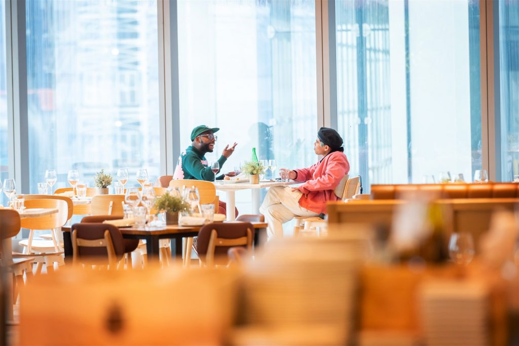 Isolated Diners talking and having food in restaurant